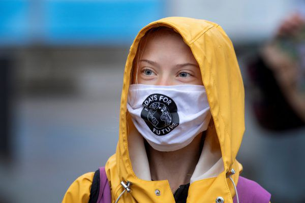 Greta Thunberg mit Fridays for Future-Maske.   AP/Gow