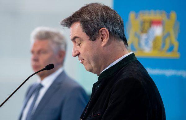 Für Markus Söder (o.) und Dieter Reiter (u.) war die Entscheidung keine leichte.